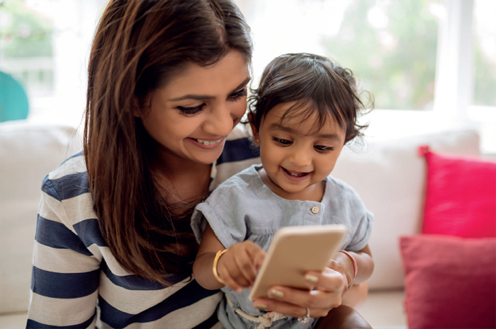 Woman and child looking at mobile device